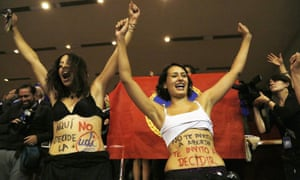 Two women celebrate the passing of the law to legalize abortion in Chile, 17 March 2016.