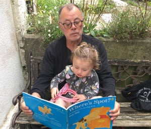 Ian Whitwham reading to his granddaughter