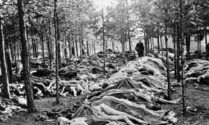 Piles of bodies await burial at the Bergen-Belsen concentration camp in Germany after it was liberated by British troops, 1945.