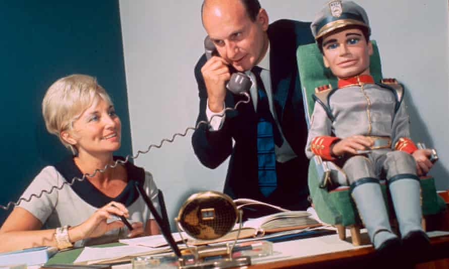 Sylvia Anderson in 1966 with her husband Gerry and a model of Troy Tempest, star of their series Stingray.