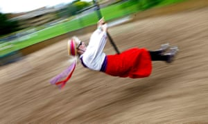 A dancer from Rivington Morris, from Lancashire, plays on a swing