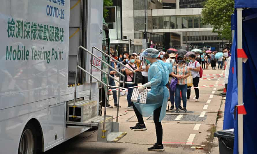 Migrant workers queue up for Covid-19 testing in the Central district of Hong Kong on Saturday.