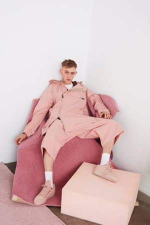 Pink jacket and trousers, white shirt, beige trainers, white socks