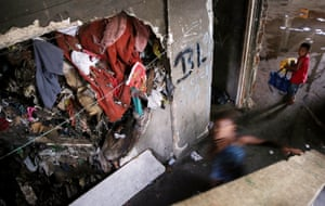 Young people gather in an occupied building in the Mangueira favela