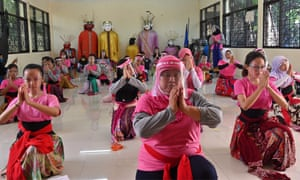 An Indonesian traditional dance class takes place in Jakarta on 9 August 2020, with participants wearing face shields to limit the spread of coronavirus.