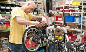 Assembling a folding bike at the Brompton Bicycle factory in Brentford, south-west London
