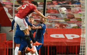 Harry Maguire (up) of Manchester United wins a header.