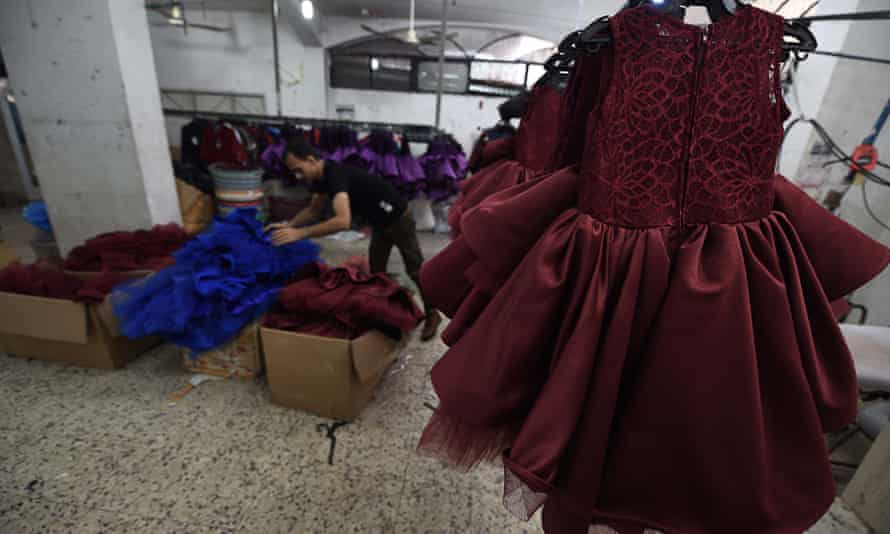 Dresses are seen at a textile factory near Kerem Shalom the commercial border crossing with Israel to the east of Rafah in the south of the Gaza Strip