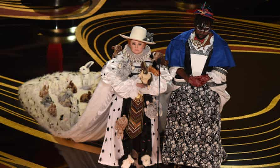 Melissa McCarthy and Brian Tyree Henry on stage on Sunday night.