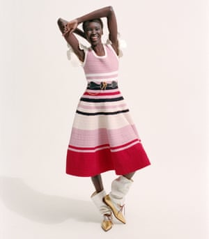 Alek wears flare hem striped dress, heart belt and pointed lace up boots all by JW Anderson (j-w-anderson.com).