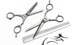 Hairdresser comb and scissors on white background
