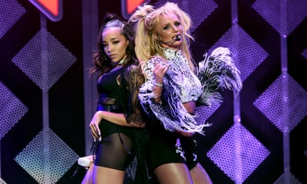 Tinashe performs with Britney Spears in December 2016.