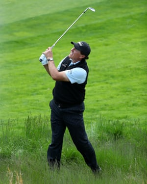 Phil Mickelson slugs his second shot on the 6th out of the rough.