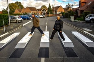 People cross the first 3D road crossing in France, created to encourage motorists to slow down in proximity to a school.