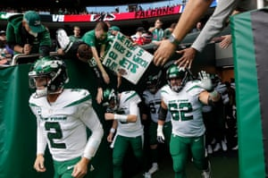 Zach Wilson, the New York Jets quarterback and No 2 overall draft pick, comes out of the tunnel with his teammates as Jets fans look on.