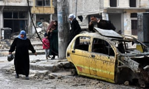 Syrian civilians from the al-Sukari neighbourhood flee during the ongoing government forces military operation to retake remaining rebel-held areas in the northern embattled city of Aleppo on Wednesday.