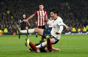 Tottenham Hotspur's Heung-Min Son and Sheffield United's Chris Basham in action during their 1-1 draw.