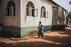 A man hurries to attend Friday prayers in Pemba