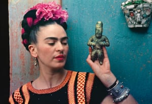 Frida with Olmeca Figurine, Coyoacán, 1939