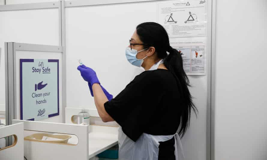 An NHS worker prepares an AstraZeneca vaccine at a Boots pharmacy in the City of London.