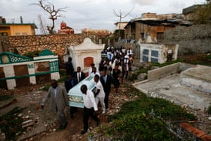 People carry the coffin of a woman who died during Hurricane Matthew in Jérémie