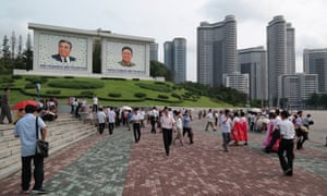 More giant portraits of the Kims, below the Changjon Street apartments – nicknamed Pyonghattan by foreign diplomats – which were completed last year in less than 12 months.