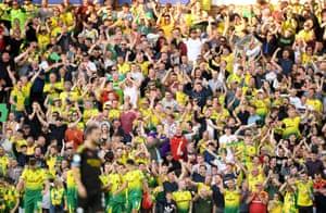 Norwich City fans celebrate their side's third goal scored by Teemu Pukki.
