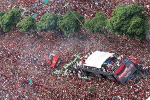 Rio de Janeiro, BrazilA coach carrying the players of Flamengo football club makes it's way through a sea of supporters during a parade to celebrate winning the Copa Libertadores final against River Plate of Argentina.