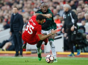 Liverpool's Kevin Stewart battles Plymouth Argyle's Paul Arnold Garita as The Green Army held The Reds to a goalless draw at Anfield.