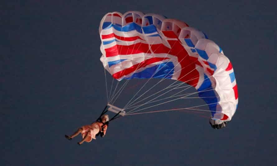 A performer playing the role of the Queen parachutes from a helicopter during the opening ceremony of London 2012.