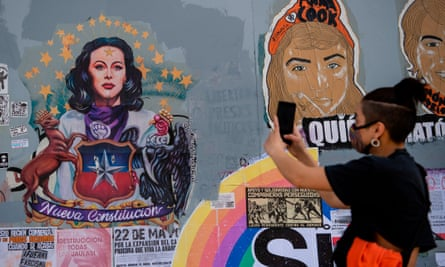Graffiti in Santiago in support of the referendum. The constitution facilitated the privatisation of public sectors, helping Chile became one of Latin America's richest but most unequal countries.