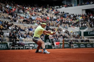 Spain's Rafael Nadal plays a shot against Switzerland's Roger Federer during the semi-final of the French Open tennis tournament at the Roland Garros in Paris on 7 June.