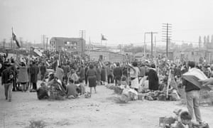Families seeking new homes gather on the outskirts of Santiago in 1967.