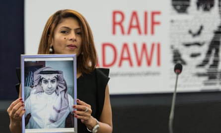 Ensaf Haidar, wife of jailed Saudi blogger Raif Badawi, holds a picture of her husband in the European Parliament in Strasbourg, France, which awarded him its Sakharov Prize for Freedom of Thought in 2015.