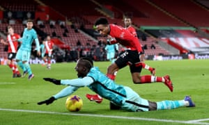 Liverpool's Sadio Mane goes down after being tackled by Southampton's Kyle Walker-Peters.