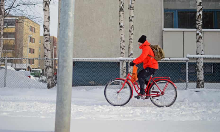 A cyclist in Rovaniemi, Finland – a city which is six miles south of the Arctic Circle.