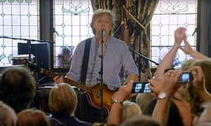 Sir Paul McCartney performs at the Philharmonic Dining Rooms in Liverpool.