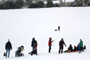 Families and dog-walkers enjoying the snow in Salisbury, Wiltshire.