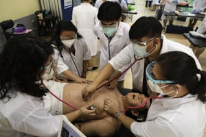 Manila, Philippines Medical students perform an exercise on an electronic dummy after some face-to-face classes resumed at the University of Santo Tomas