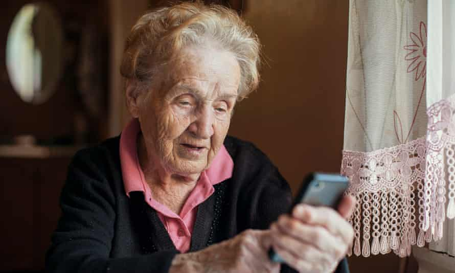 An elderly woman uses a smart phone. The coronavirus crisis has made older people find new ways to connect.