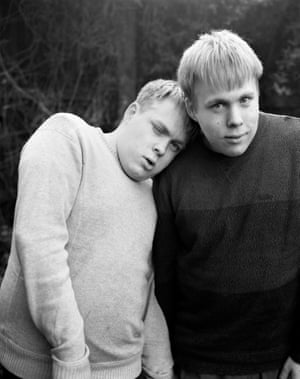 Twin boys leaning on each other