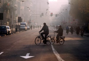 Cyclist in pollution in Milan