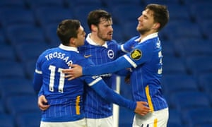 Leandro Trossard (L) of Brighton & Hove Albion celebrates with team-mates.