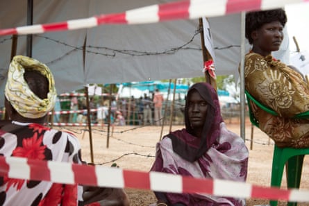 Women wait in line for food distribution at the UN Protection of Civilians site in Tomping, South Sudan