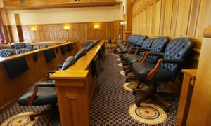 The jury box in a US courthouse: deliberation by juries lends credibility to the legal system.