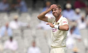 England's Stuart Broad reacts after he bowls .
