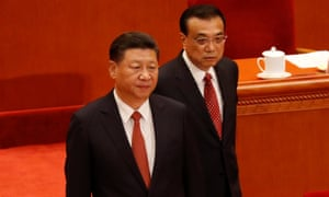 Xi Jinping and Premier Li Keqiang arrive for the ceremony to mark the 90th anniversary of the founding of the China's People's Liberation Army at the Great Hall of the People in Beijing.