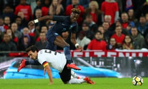 England's Tammy Abraham, who was confident and demanding, leaps over Mats Hummels at Wembley.