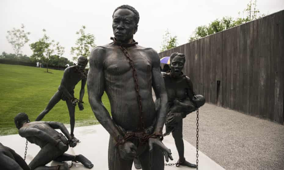 A sculpture depicting the slave trade at the entrance of the National Memorial For Peace And Justice.