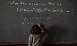 Still from Hidden Figures film: woman writing equations on blackboard